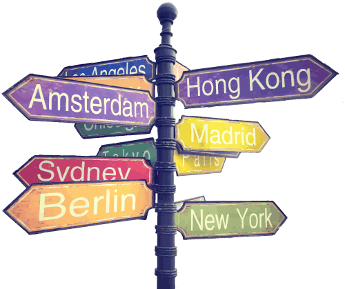 Signs with a lot of city names on it for a global direction